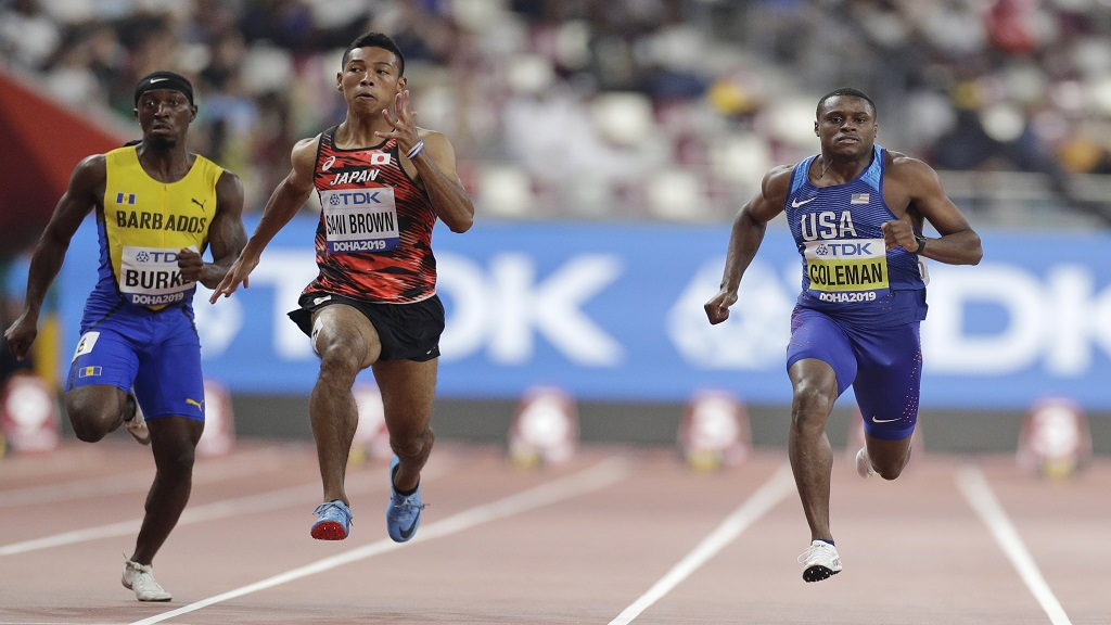 From right, Christian Coleman of the United States, Japan's Abdul Hakim Sani Brown and Barbados' Mario Burke compete during the men' 100 metres heats at the World Athletics Championships in Doha, Qatar, Friday, Sept. 27, 2019. (AP Photo/Petr David Josek).