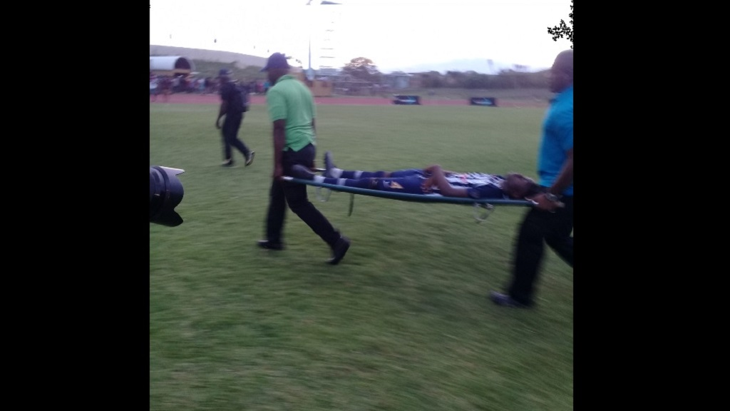 Jamaica College player Terrence Francis being stretchered off the field of play at a Manning Cup football match against Wolmer's Boys' School at Stadium East in St Andrew on Monday afternoon, after a lightning strike during the game. (Photos: Job Nelson)