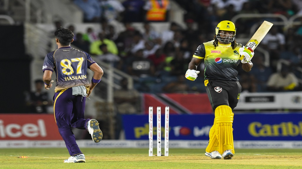 Chris Gayle (right) of Jamaica Tallawahs bowled by Muhammad Hasnain (left) of Trinbago Knight Riders during match 10 of the Hero Caribbean Premier League Rat Sabina Park on Friday, September 13, 2019. (Photo by Randy Brooks - CPL T20/Getty Images).