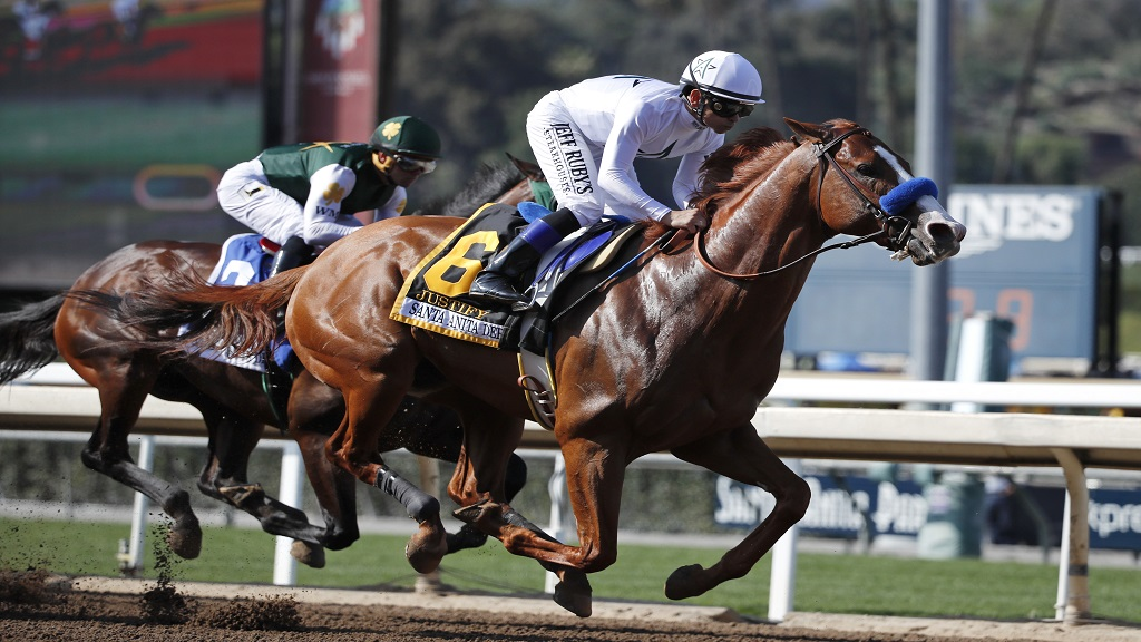 In this April 7, 2018, file photo, Justify, ridden by Mike Smith, gallops past Bolt d'Oro, left, with jockey Javier Castellano, during the Santa Anita Derby horse race at Santa Anita in Arcadia, Calif. Justify won the race, and Bolt d'Oro came in second.