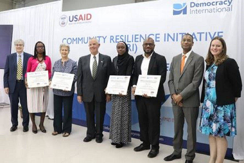(Left to right) Eric Bjornlund president of Democracy International, Dionne Guiscard; Rochelle Nakhid of