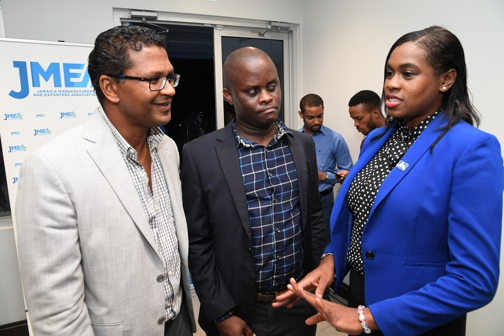 O'Neil Dacres (centre), workplace banking coordinator at JN Bank, and Richard Pandohie (left), President of the Jamaica Manufacturers and Exporters Association (JMEA), listen keenly as Jacqueline Shaw-Nicholson, communication and client services manager, JN Small Business Loans, make a point, during the JMEA nominations ceremony.