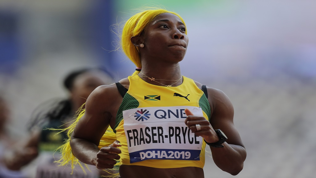 Shelly-Ann Fraser-Pryce, of Jamaica, wins her first round heat of the women's 100m at the World Athletics Championships in Doha, Qatar, Saturday, Sept. 28, 2019.  Fraser-Pryce clocked 10.80 seconds for the victory, the fastest qualifying time heading into the semifinals on Sunday. (AP Photo/Petr David Josek).