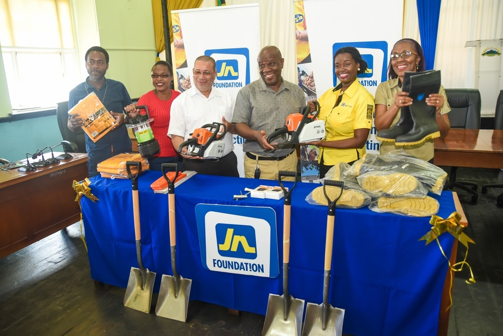 Mayor of Falmouth, Councillor Collin Gager (third right) shows off hurricane supplies from Onyka Barrett Scott (second right), general manager of the JN Foundation and Rose Miller (right), grants manager at the JN Foundation, recently. Sharing in the presentation were (from left): Kayon Hall, acting Superintendent of Roads and Works; Dion Hylton-Lewis , Parish Disaster Coordinator and Andrew Harrison, chief executive officer.