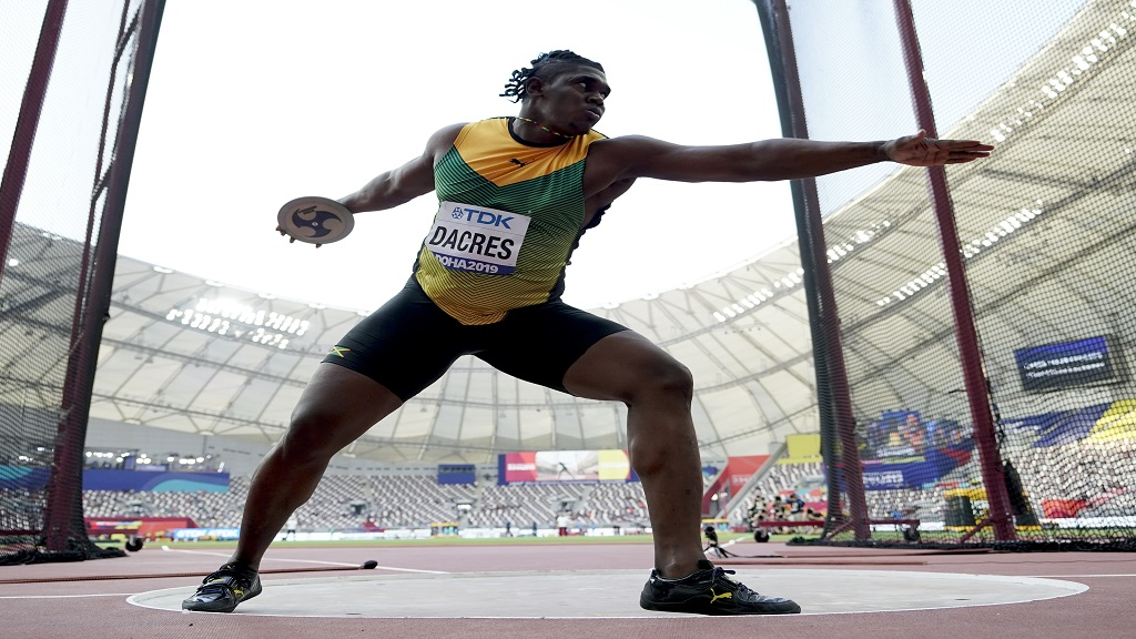 Fedrick Dacres, of Jamaica, competes in the qualification round of the men's discus throw at the World Athletics Championships in Doha, Qatar, Saturday, Sept. 28, 2019.   Dacres is in the final, which takes place on Monday, starting at 1:15 pm Jamaica time. (AP Photo/David J. Phillip).