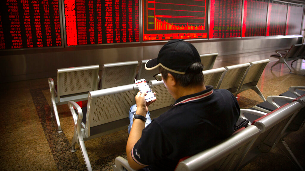 Chinese investors monitor stock prices at a brokerage house in Beijing, Thursday, Sept. 5, 2019. Asian shares were mostly higher Thursday amid encouraging global developments, including British lawmakers seeking a less chaotic exit from the European Union and easing political tensions in Hong Kong. (AP Photo/Mark Schiefelbein)