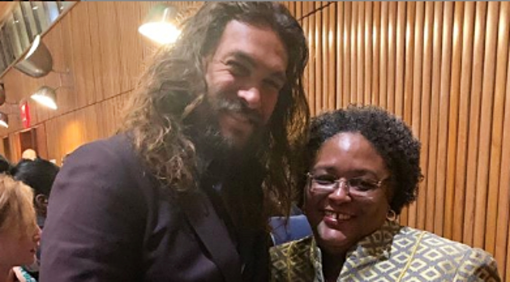 Jason Momoa and Barbados Prime Minister Mia Mottley at the UN Headquarters in NYC.