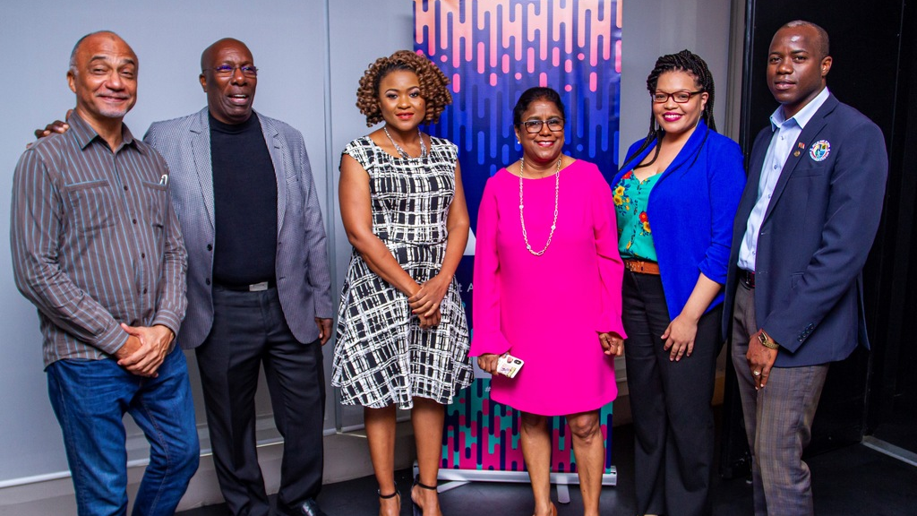 Trade Minister Paula Gopee Scoon in pink with Culture Minister Dr Nyan Gadsby-Dolly and MusicTT executives at the launch of AMPT