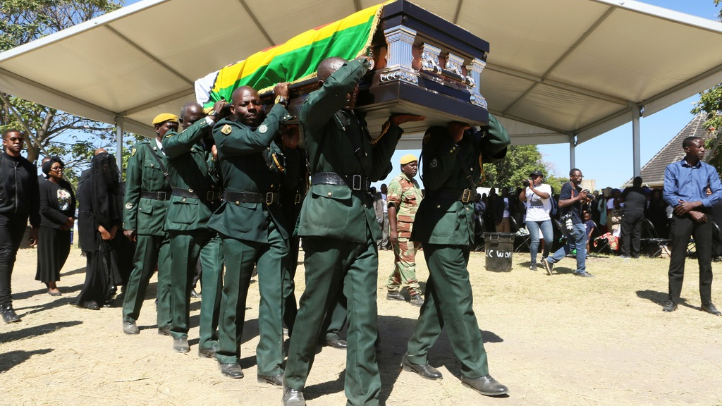 The coffin carrying the body of former Zimbabwean President Robert Mugabe is seen at during mass at his rural home in Zvimba, about 100 kilometers north west of the capital Harare, Saturday. Sept, 28, 2019. (AP Photo/Tsvangirayi Mukwazhi)
