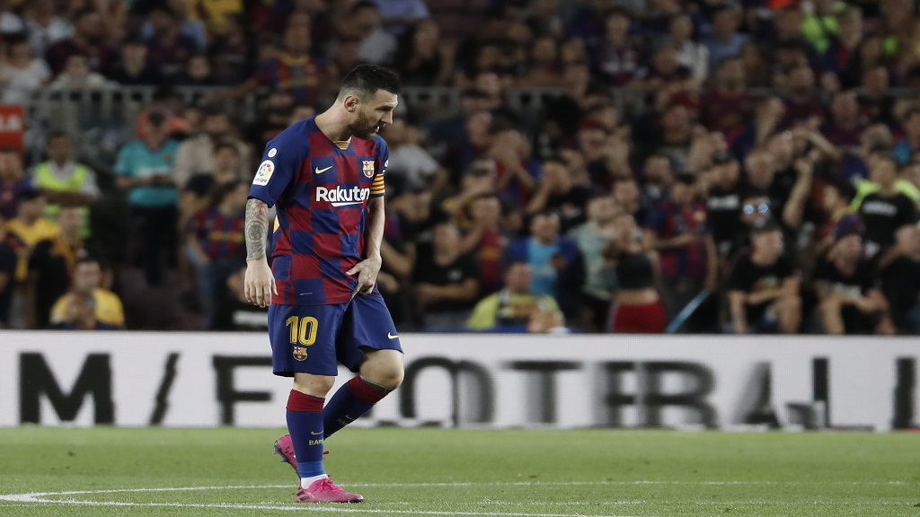 Barcelona's Lionel Messi walks on the pitch after getting hurt during the Spanish La Liga football match against Villarreal CF at the Camp Nou stadium in Barcelona, Spain, Tuesday, Sep. 24, 2019. (AP Photo/Joan Monfort).