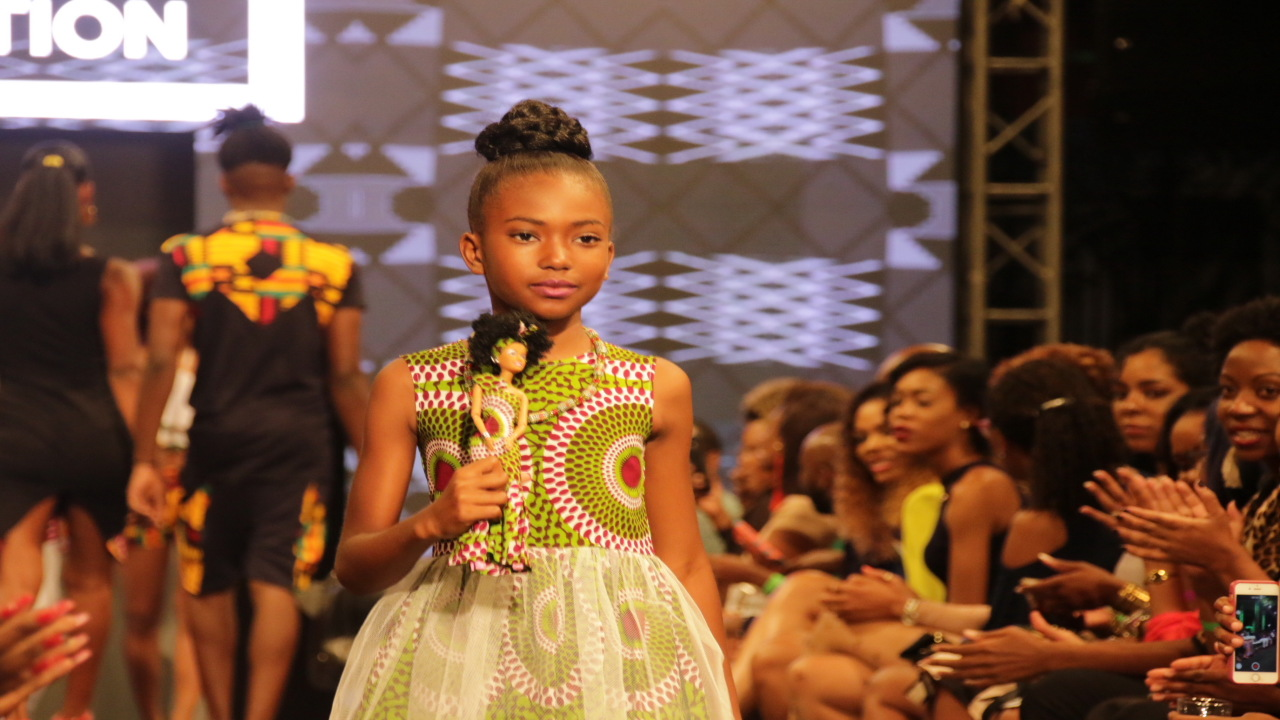 A young model walks the runway during Pulse's Caribbean Fashion Week.