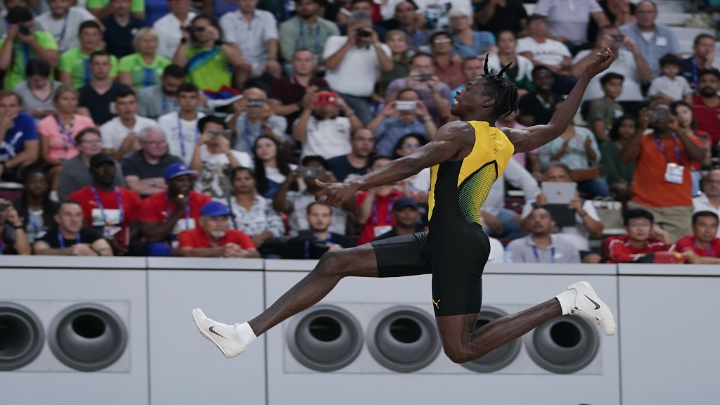 Tajay Gayle, of Jamaica, competes in the men's long jump final at the World Athletics Championships in Doha, Qatar, Saturday, Sept. 28, 2019. (AP Photo/David J. Phillip).