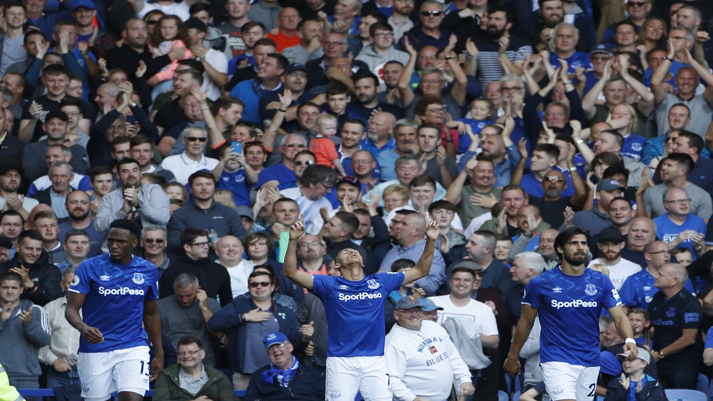 Everton's Richarlison, centre celebrates after scoring his side's third goal during the English Premier League match between Everton and Wolverhampton Wanderers at Goodison Park in Liverpool, England, Sunday, Sept 1, 2019. (AP Photo/Rui Vieira)