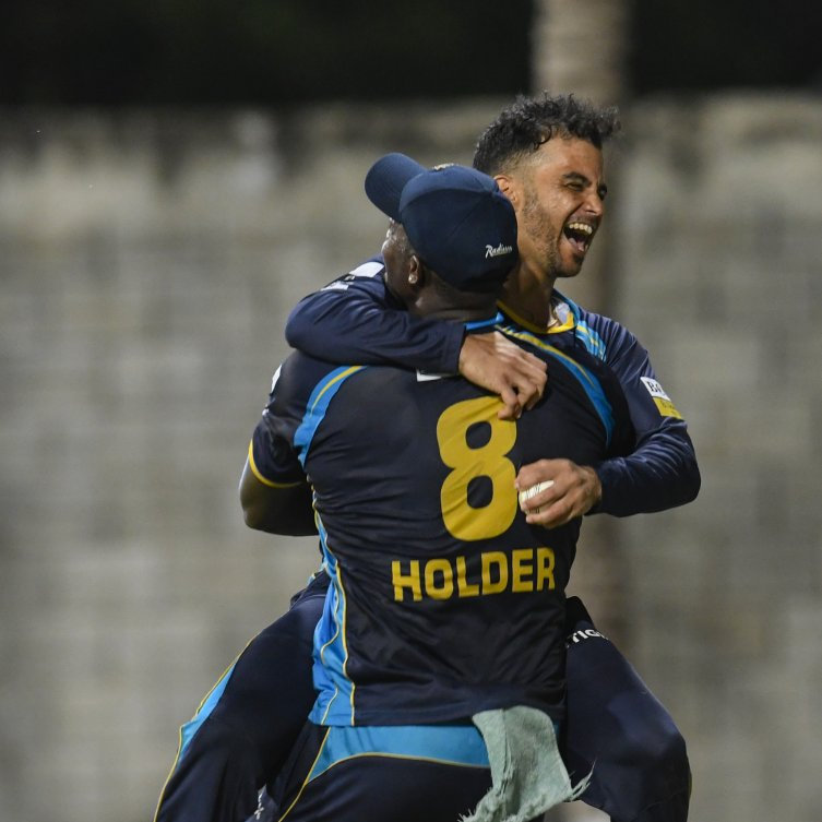 Jason Holder and JP Duminy celebrate Barbados Tridents 63-run win over the TKR