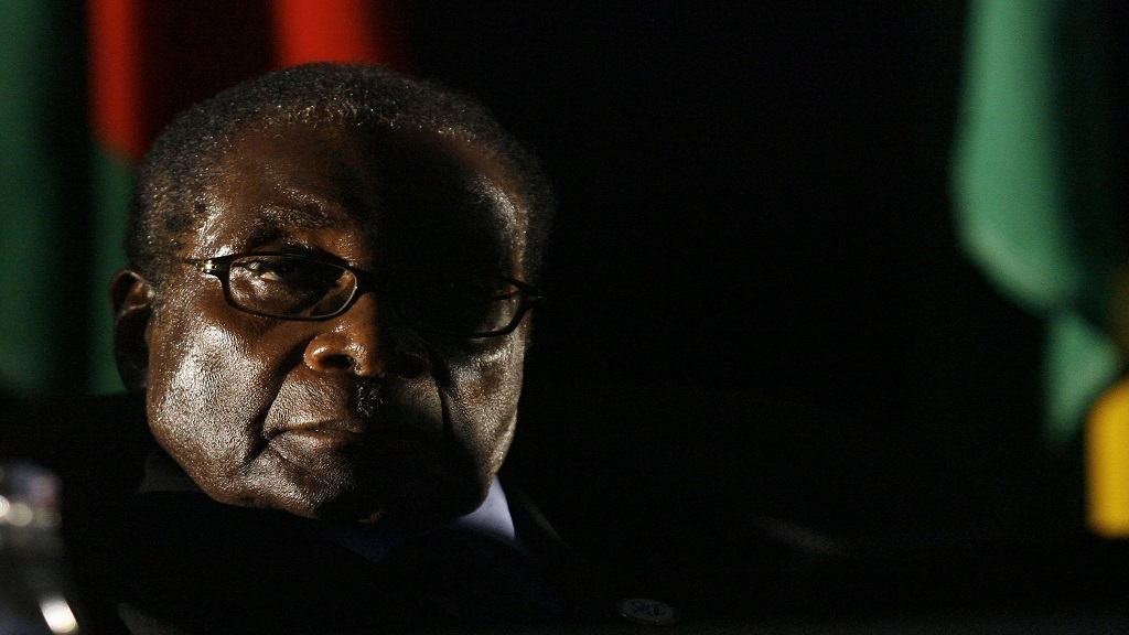 In this Sunday, August. 17, 2008 file photo, Zimbabwean President Robert Mugabe is seen at the closing ceremony of the 28th Southern African Development Community summit of heads of state and government, in Johannesburg, South Africa. Mugabe, the former leader of Zimbabwe forced to resign in 2017 after a 37-year rule whose early promise was eroded by economic turmoil, disputed elections and human rights violations, has died. He was 95.(AP Photo/Jerome Delay, File)