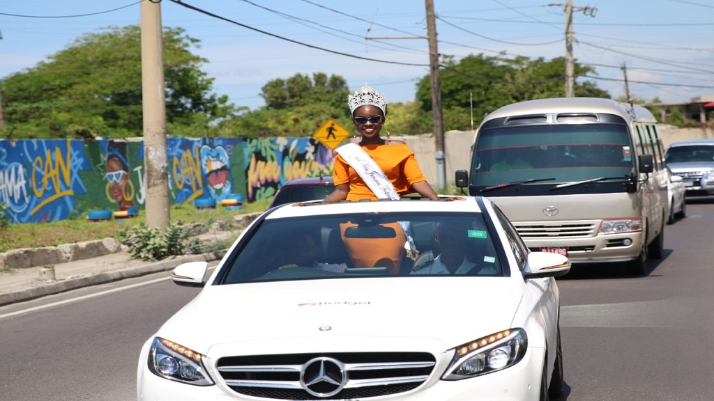 Miss Jamaica Festival QueenKhamara Wrightsmiles during her motorcade in St Catherine on Wednesday. (PHOTOS: JCDC)