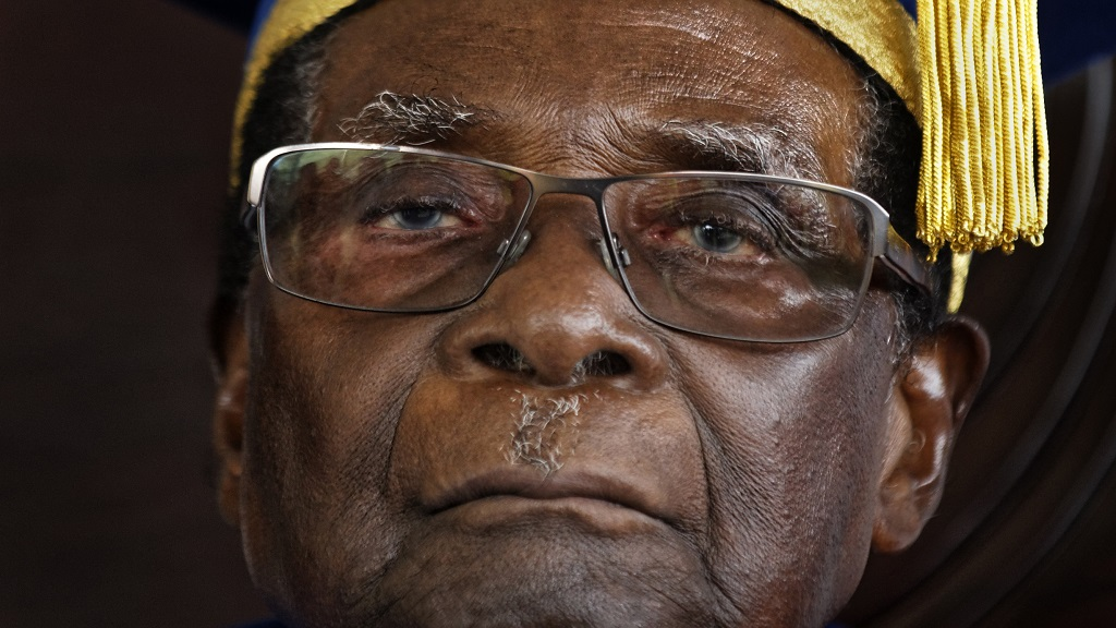 In this Friday, November 17, 2017 file photo, Zimbabwe's President Robert Mugabe officiates at a student graduation ceremony at Zimbabwe Open University on the outskirts of Harare, Zimbabwe. On Friday, Sept. 6, 2019, Zimbabwe President Emmerson Mnangagwa said his predecessor Robert Mugabe, age 95, has died. (AP Photo/Ben Curtis, File)