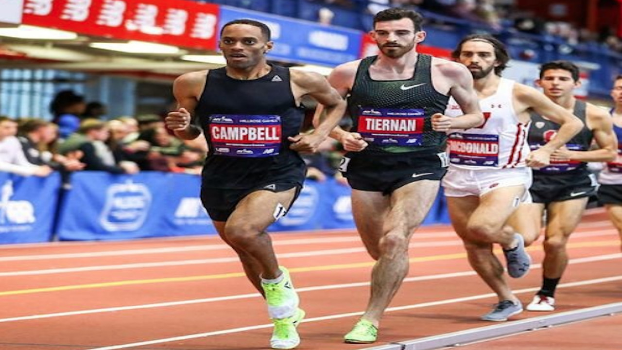 Kemoy Campbell (left) competes in a long distance race.