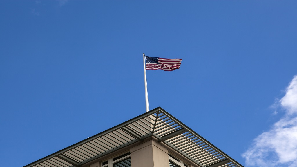 Stock photo of a USA flag at an embassy.