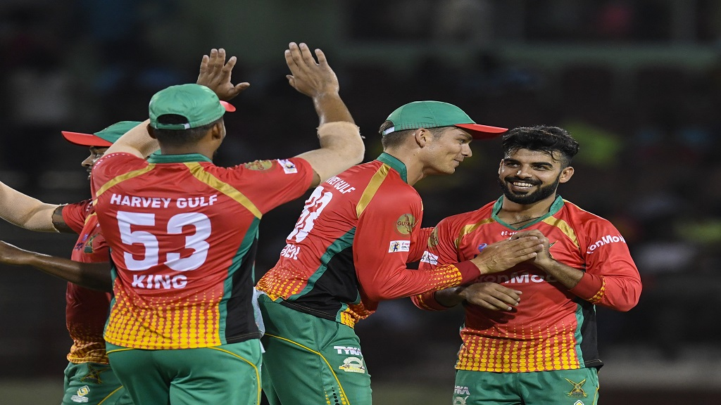 Chris Green (centre) and Shadab Khan (right) of Guyana Amazon Warriors celebrate the dismissal of Darren Sammy of St Lucia Zouks during match 2 of the Hero Caribbean Premier League at the Guyana National Stadium on September 5, 2019 in Providence, Guyana. (Photo by Randy Brooks - CPL T20/Getty Images).