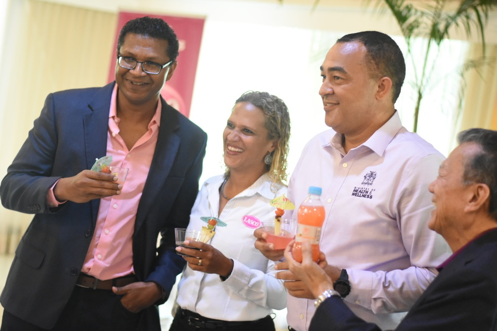 From left to right: President of the Jamaica Manufacturer's Association Richard Pandohie, Beverage Marketing Manager at Lasco Manufacturing Danielle Cunningham, Health and Wellness Minister Dr Christopher Tufton, and Chairman of the Lasco Group of Companies Lascelles Chin at the official launch of the iCool Reduced Sugar drink on Thursday. (Photo: Marlon Reid)