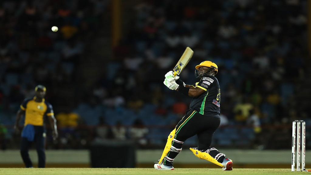 Dwayne Smith of Jamaica Tallawahs hits six over midwicket during the Hero Caribbean Premier League match against St Lucia Zouks at the Daren Sammy National Cricket Stadium on Friday, September 27, 2019 in Gros Islet, Saint Lucia.  Smith top-scored for the Tallawahs with 58. (Photos by Ashley Allen - CPL T20/Getty Images).