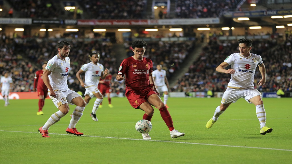 Liverpool's Curtis Jones, centre, in action during the League Cup football match against Milton Keynes Dons at the MK Dons Stadium, Milton Keynes England, in London, England, Wednesday, Sept. 25, 2019. (AP Photo/Leila Coker).