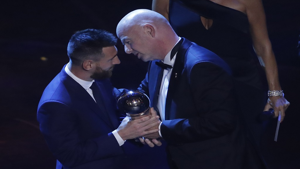 Argentinian Barcelona player Lionel Messi receives the Best FIFA men's player award from FIFA president Gianni Infantino during the ceremony of the Best FIFA Football Awards, in Milan's La Scala theater, northern Italy, Monday, September 23, 2019. (AP Photo/Antonio Calanni)