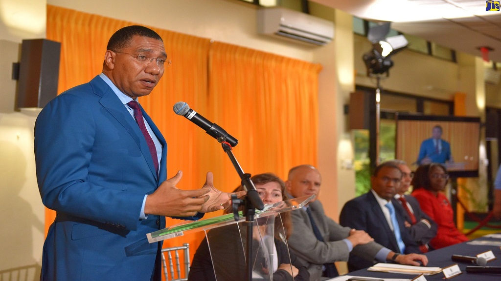 Prime Minister Andrew Holness (at podium) highlights a point while addressing a press conference at the Office of the Prime Minister on Wednesday. (Photo JIS)
