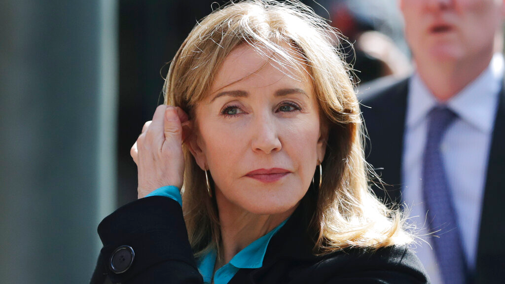 In this April 3, 2019 file photo, actress Felicity Huffman arrives at federal court in Boston to face charges in a nationwide college admissions bribery scandal. (AP Photo/Charles Krupa, File)