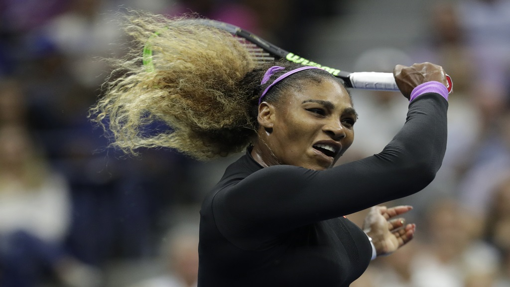 Serena Williams, of the United States, returns a shot to Elina Svitolina, of Ukraine, during the semifinals of the U.S. Open tennis championships Thursday, Sept. 5, 2019, in New York. (AP Photo/Adam Hunger).
