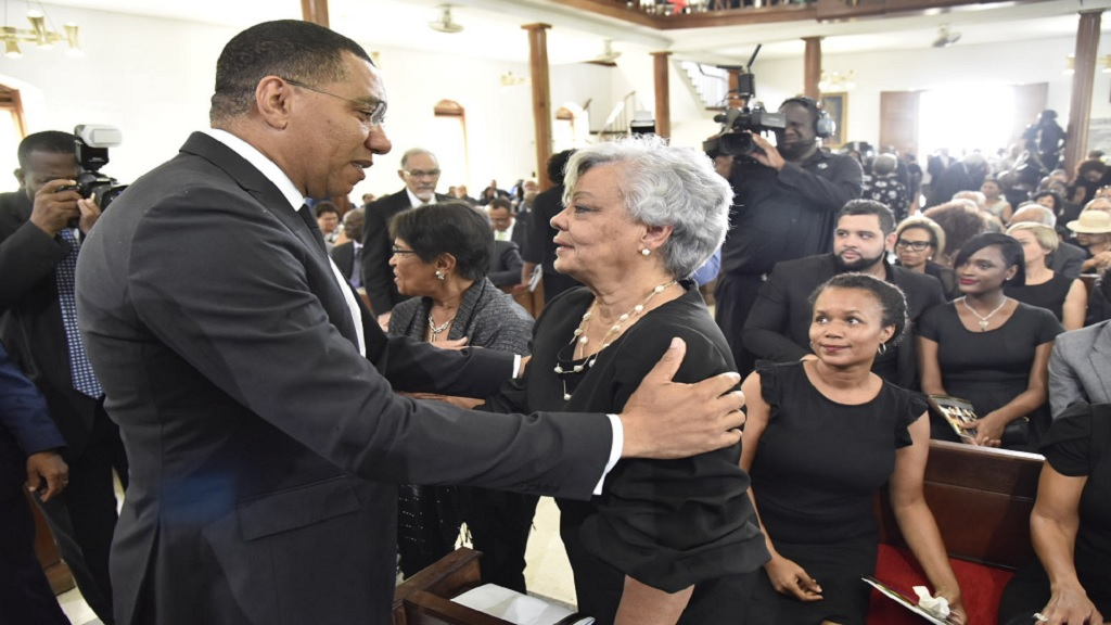 Prime Minister Andrew Holness offers condolences to Wilma Baugh, the widow of the late former Deputy Prime Minister, Dr Kenneth Baugh. Occasion was the Service of Thanksgiving for the life of Baugh at the University of the West Indies (UWI) Chapel, Mona on Thursday. (PHOTOS: JIS)