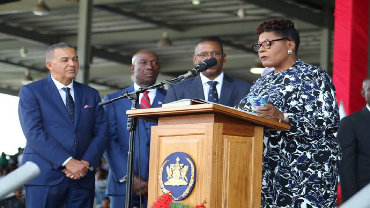 From left: Justice Anthony Thomas Aquinas Carmona, former President of the Republic of Trinidad and Tobago, Prime Minister Keith Rowley and Chief Justice, Ivor Archie look on as Her Excellency Paula-Mae Weekes, President of the Republic of Trinidad and Tobago takes the oath of office. Photo via The Office of the Prime Minister of Trinidad and Tobago.
