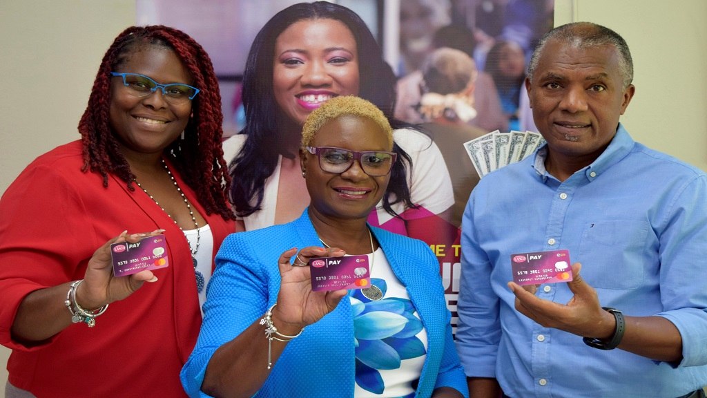 From left: LASCO Financial Services Limited Marketing Manager Danielle Harris-Drysdale; Managing Director Jacinth Hall-Tracey; and Chief Executive Officer at Alliance Payment Services Limited, Lennox Robinson show off the new ePay MasterCard.