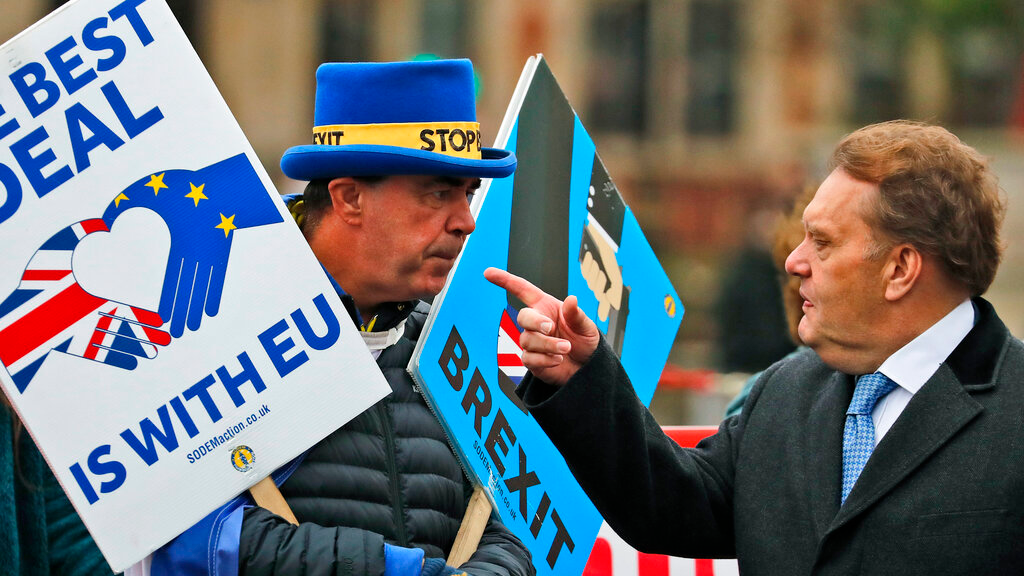 """Protestors react as they demonstrate in front of the Houses of Parliament in London, Wednesday, March 6, 2019. Britain's chief law officer said Wednesday that Brexit negotiations with the European Union had got to """"the meat of the matter,"""" after Northern Ireland's top civil servant warned that a disorderly U.K. exit could destabilize both the economy and the peace process. (AP Photo/Frank Augstein)"""