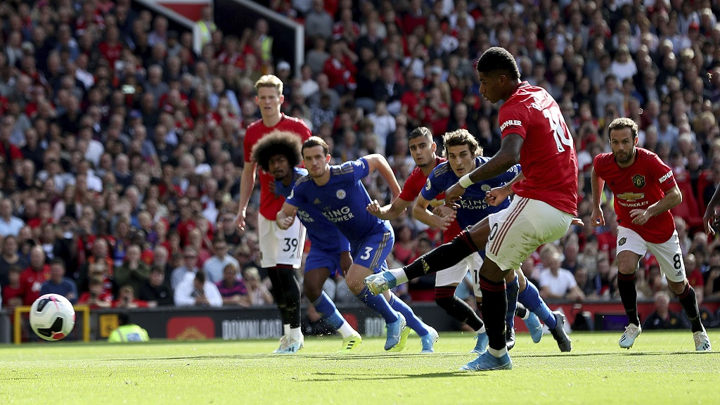 Manchester United's Marcus Rashford scores from the penalty spot during the English Premier League football match against Leicester City at Old Trafford Stadium, Manchester England. Saturday, Sept. 14 2019 (Martin Rickett/PA via AP).