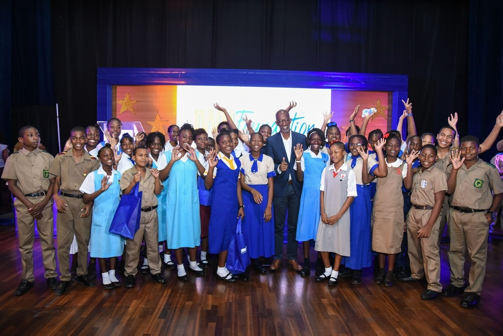 Corporate secondary recipients of the JWN Foundation scholarships and JWN Foundation Chairman Clement Lawrence (centre) are a picture of excitement at the JWN Foundation scholarship awards ceremony.