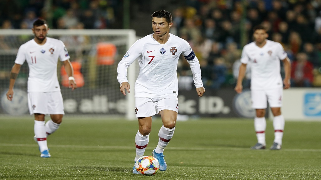 Portugal's Cristiano Ronaldo, centre, controls the ball during the Euro 2020 group B qualifying football match against Lithuania at LFF stadium in Vilnius, Lithuania, Tuesday, Sept. 10, 2019. (AP Photo/Mindaugas Kulbis).