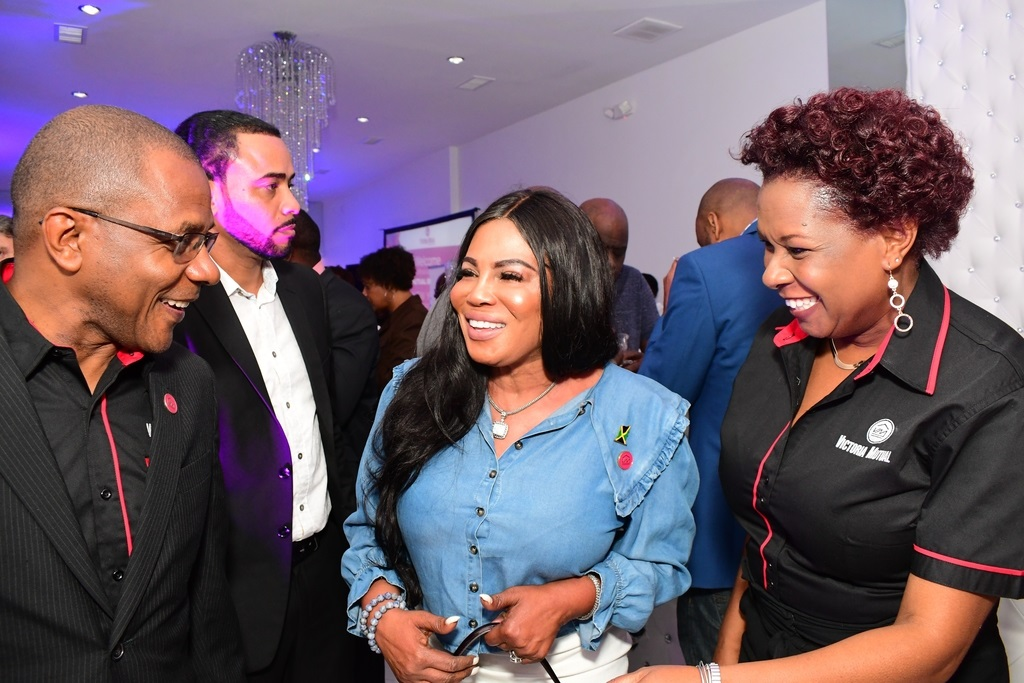 Sharing in a light moment, Courtney Campbell  (left), President and CEO of Victoria Mutual Group, Alsion Roach Wilson (centre) Jamaica's Consul General to New York and  Natasha Service (right)  Chief Representative Officer, VMBS New York Representative Office, at the official launch of the office in New York City
