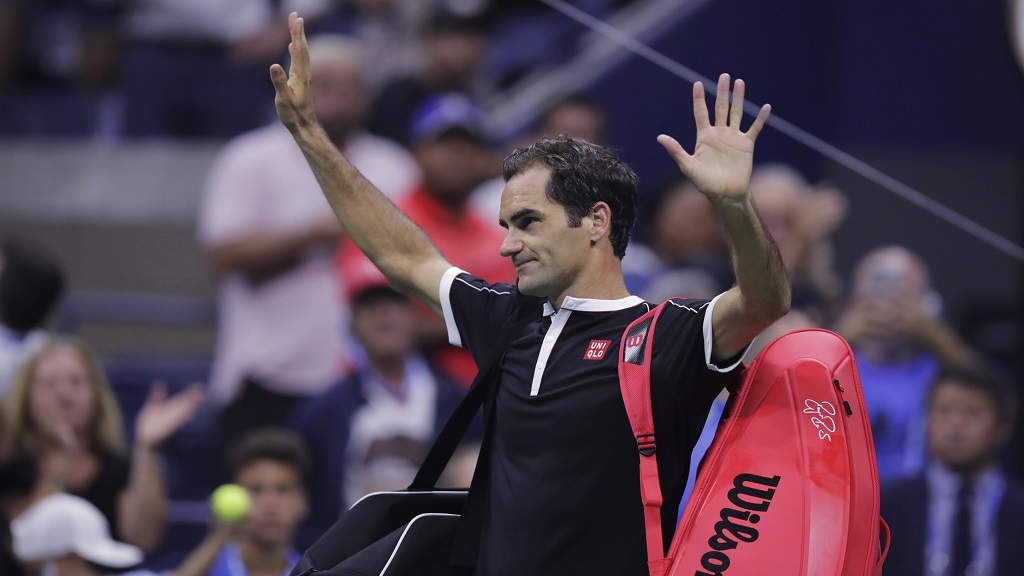 Roger Federer, of Switzerland, thanks the crowd after a loss to Grigor Dimitrov, of Bulgaria, during the quarterfinals of the U.S. Open tennis championships Tuesday, Sept. 3, 2019, in New York.