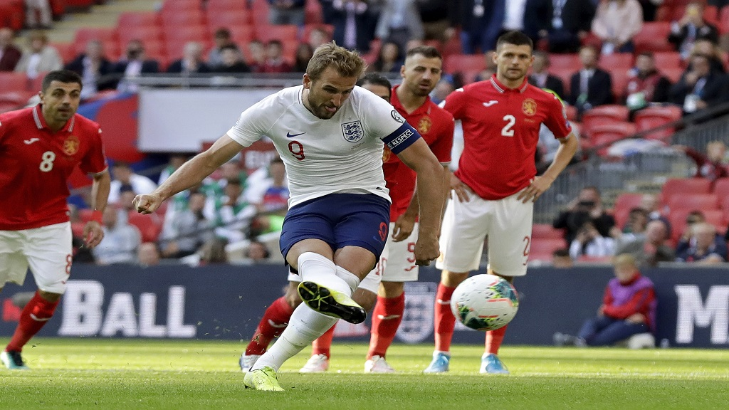 England's Harry Kane scores his side's second goal from the penalty spot during the Euro 2020 group A qualifying football match against Bulgaria at Wembley stadium in London, Saturday, Sept. 7, 2019. (AP Photo/Matt Dunham).