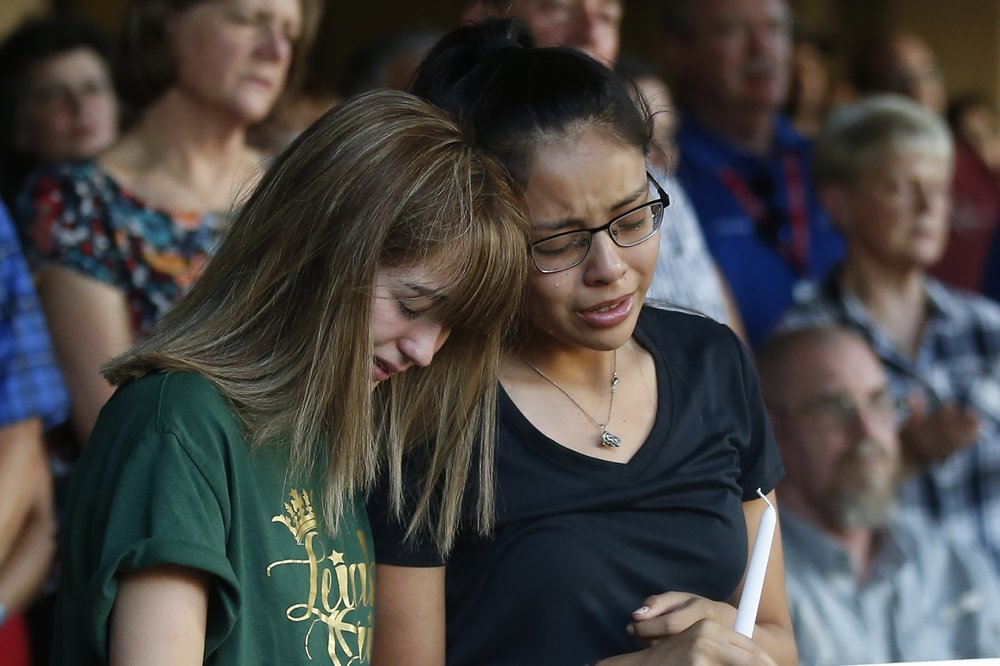 High School students Celeste Lujan, left, and Yasmin Natera mourn their friend Leila Hernandez, one of the victims of the Saturday shooting in Odessa, at a memorial service Sunday, Sept. 1, 2019, in Odessa, Texas. (AP Photo/Sue Ogrocki)