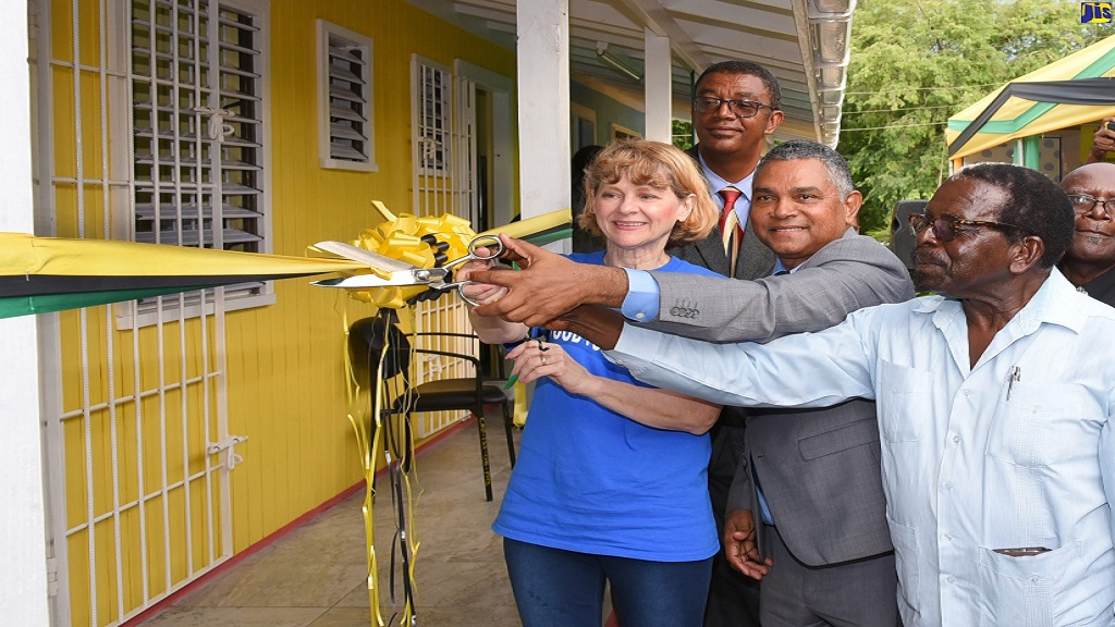 American philanthropist, Denise Di Biase (left); Deputy Chairman of the Southern Regional Health Authority (SRHA), Michael Stern (centre); and Member of Parliament (MP) for North Central Clarendon, Pearnel Charles Snr, cut the ribbon to officially open the new Rock River Health Centre on September 18. In the background at left is Manager for the Clarendon Health Services, Joseph Grant.