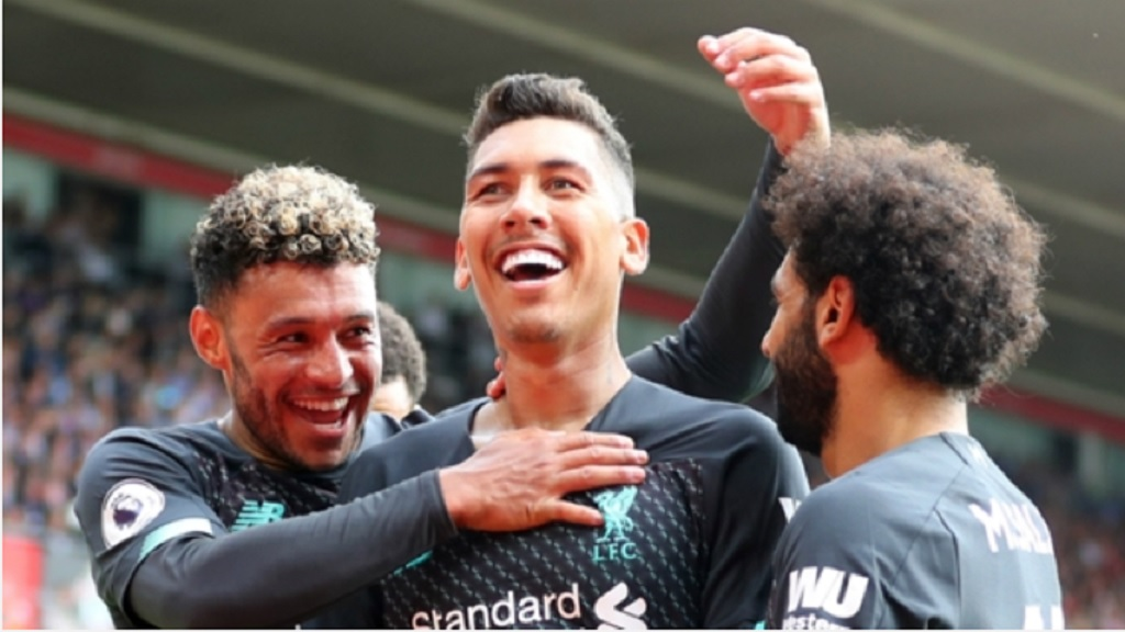Roberto Firmino celebrates with his Liverpool team-mates.