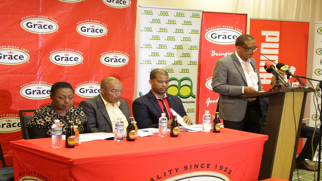 Lincoln Eatmon, First Vice President of the Jamaica Athletics Administrative Association (JAAA)  announcing Jamaica's team to the IAAF World Athletics Doha 2019  at  Courtyard by Marriott Kingston on Wednesday, September 11. Listening keenly are (from left) Sport Minister Olivia Grange, President of the JAAA Dr Warren Weir and CEO - Grace Food Domestic Frank Fames. (PHOTO: Ramon Lindsay).