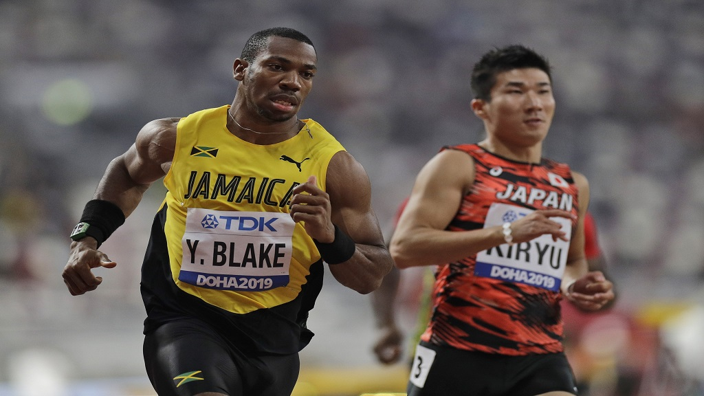 Jamaica's Yohan Blake and Yoshihide Kiryu of Japan compete in a men's 100 metres heat at the World Athletics Championships in Doha, Qatar, Friday, Sept. 27, 2019. (AP Photo/Petr David Josek).