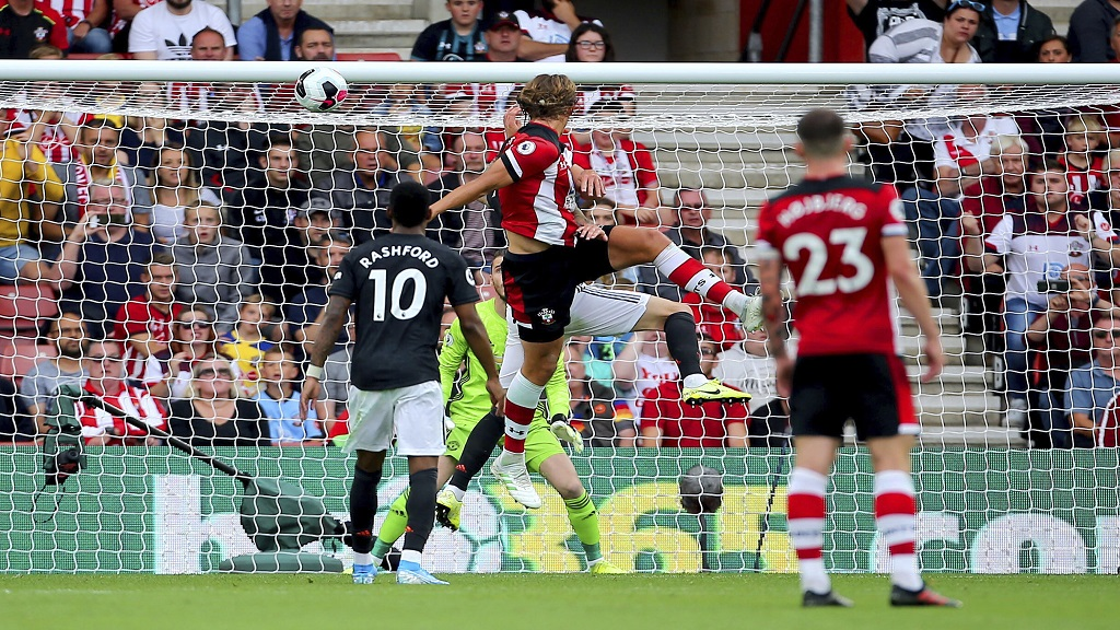 Southampton's Jannik Vestergaard, centre, scored against Manchester United during their English Premier League football match at St Mary's, Southampton, England, Saturday Aug. 31, 2019. (Mark Kerton/PA via AP).