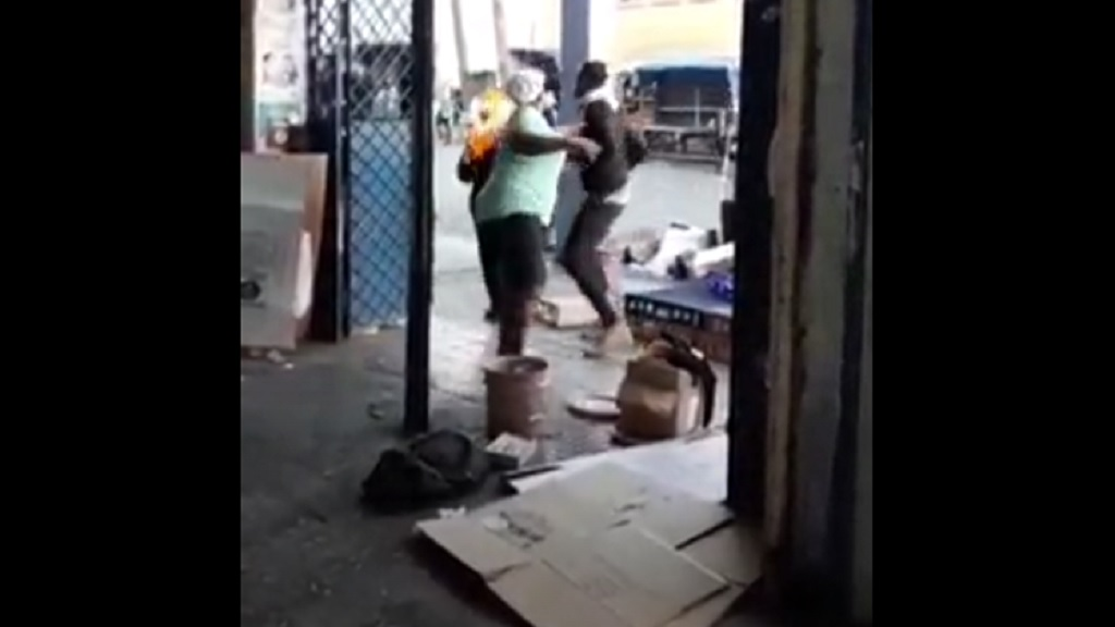 A screen grab from a video of a woman's clothing on fire after she was doused with a liquid and set ablaze by a man in downtown Kingston last week.