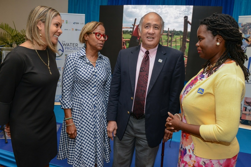 Onyka Barrett Scott (right), general manager of the JN Foundation in conversation with (from left), Leesa Kow, deputy managing director, JN Bank; Therese Turner-Jones, general manager, country representative Jamaica at the Inter- American Development Bank and Parris Lyew-Ayee, chairman of the JN Foundation at the launch of the Rainwater Harvesting & Grey Water Recycling Training to Developers at the Jamaica Pegasus recently.