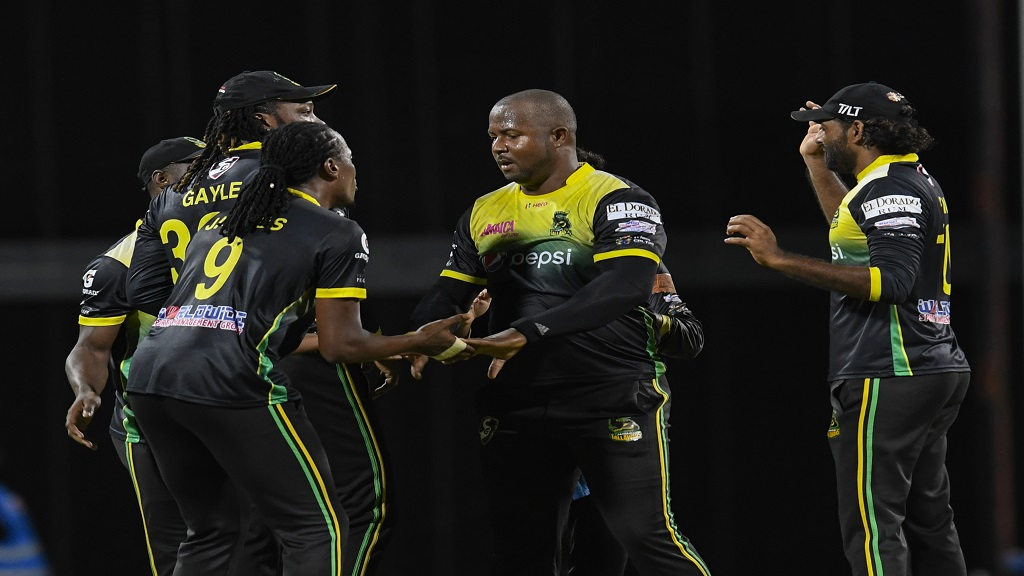 Shamar Springer (2nd left), Zahir Khan (left), Chadwick Walton (2nd right) and Imran Khan (right) of Jamaica Tallawahs celebrate the dismissal of Ashley Nurse of Barbados Tridents during match 20 of the Hero Caribbean Premier League between Barbados Tridents and Jamaica Tallawahs at Kensington Oval on Monday, September 23, 2019 in Bridgetown, Barbados. (Photos by Randy Brooks - CPL T20/Getty Images).